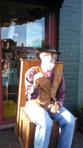 Wooden man outside a store front