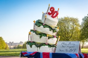 Happy Birthday Your Majester! The BFG serves up a 10ft tall scrumdidilyumptious snozzcumber filled 90th birthday cake for the Queen at Windsor Castle ahead of the release of The BFG in cinemas this July.