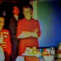 Grandma, Jeff H. Sanderson, and Big Jeff peeking over Grandma's shoulder