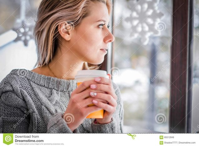 woman-drinking-coffee-looking-out-window-close-up-855128466933511100978318585.jpg