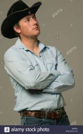 young-man-wearing-western-wear-with-arms-crossed-X66P5X