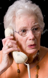 an-old-woman-receiving-bad-news-on-the-phone-uk-B1NGBH