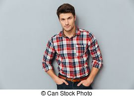 handsome-young-man-standing-with-hands-in-pockets-over-gray-background-stock-photo_csp394898201901573916819323821.jpg